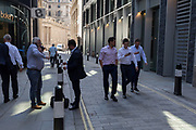 Older and younger City men in Throgmorton Street, in the City of London, the capital's financial district aka the Square Mile, on 15th May 2018, in London, UK.