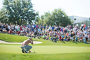 Jordan Spieth reads a putt during the final round of the AT&T Byron Nelson in Las Colinas, Texas on May 31, 2015. (Cooper Neill for The New York Times)