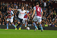 Tottenham's Erik Lamela looks to go past Villa's  Yacouba Sylla. Capital one cup 3rd round match, Aston Villa v Tottenham Hotspur at Villa Park in Birmingham on Tuesday 24th Sept 2013. pic by Andrew Orchard, Andrew Orchard sports photography.