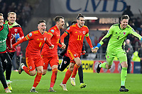 Football - 2019 / 2020 UEFA European Championships Qualifier - Group E: Wales vs. Hungary<br /> <br /> Harry Wilson of Wales., Aaron Ramsey of Wales, Gareth Bale of Wales & Wayne Hennessey of Wales  celebrates after Wales win 2-0 to qualify for Euros 2020, at Cardiff City Stadium.<br /> <br /> COLORSPORT/WINSTON BYNORTH