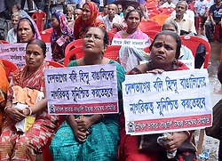August 19, 2017 - Kolkata, West Bengal, India - Hindu refugee women sit with their demand poster during the rally called for refugees demand in Kolkata. Activist of Nikhil Bharat Bangali Udbastu Samanway Samity rallied for the demands of Hindu refugees on August 19, 2017 in Kolkata. (Credit Image: © Saikat Paul/Pacific Press via ZUMA Wire)