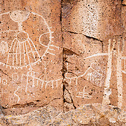 Native American petroglyphs at sunset, Eastern Sierra, California.