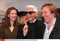 © Nicolas Khayat/ABACA. 24393-13. Paris-France, 15/3/2001. From l to r : stylist Karl Lagerfeld, Carole Bouquet and Gerard Depardieu at the Chanel Ready-to-Wear Autumn Winter 2001-2002 fashion show.