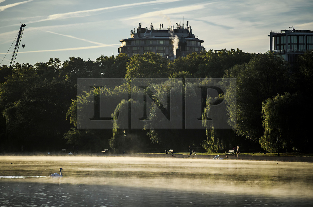 © Licensed to London News Pictures. 24/09/2018. London, UK. Serpentine lake covered in myst on a cold Autumn morning in Hyde Park, central London. Photo credit: Ben Cawthra/LNP