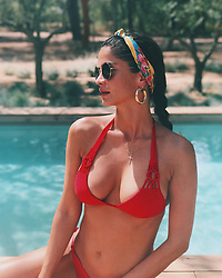 """Shermine Shahrivar releases a photo on Instagram with the following caption: """"Profondo Rosso \ud83d\udc8b\ud83d\udc8b\ud83d\udc8b"""". Photo Credit: Instagram *** No USA Distribution *** For Editorial Use Only *** Not to be Published in Books or Photo Books ***  Please note: Fees charged by the agency are for the agency's services only, and do not, nor are they intended to, convey to the user any ownership of Copyright or License in the material. The agency does not claim any ownership including but not limited to Copyright or License in the attached material. By publishing this material you expressly agree to indemnify and to hold the agency and its directors, shareholders and employees harmless from any loss, claims, damages, demands, expenses (including legal fees), or any causes of action or allegation against the agency arising out of or connected in any way with publication of the material."""