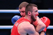 Ibragim Bazuev of Germany (red) and Stepan Hrekul of Ukraine (blue) compete in the Men's Light-heavyweight preliminaries during The Road to Tokyo European Olympic Boxing Qualification, Sunday, March 15, 2020, in London, United Kingdom. (Mitchell Gunn-ESPA-Images/Image of Sport)