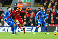 Vicente Iborra of Leicester City (l) tackles Mohamed Salah of Liverpool. Premier League match, Liverpool v Leicester City at the Anfield stadium in Liverpool, Merseyside on Saturday 30th December 2017.<br /> pic by Chris Stading, Andrew Orchard sports photography.