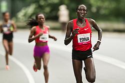 NYRR Mini 10K road race (40th year); Edna Kiplagat, Kenya, breaks away from lead pack