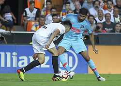 August 20, 2018 - Carlos Soler of Valencia and  Diego Costa of Atletico de Madrid in action during the spanish league, La Liga, football match between ValenciaCF and Atletico de Madrid on August 20, 2018 at Mestalla stadium in Valencia, Spain. (Credit Image: © AFP7 via ZUMA Wire)