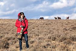 Scott Hunter photographing mustangs in Farson Wyoming