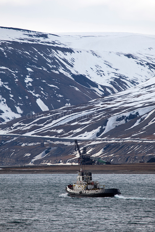 Tugboat sailing to the port of Longyearbyen, Spitsbergen, in the archipelago of Svalbard.