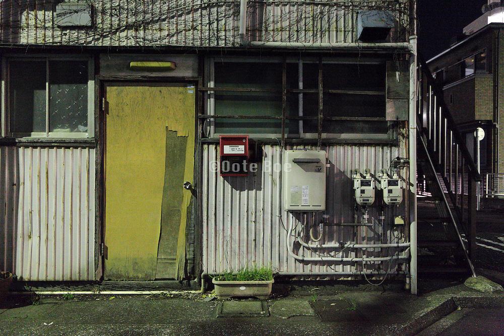 old decaying building in residential neighborhood Japan