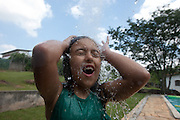 Itupeva_SP, Brasil...Crianca se refrescando em piscina em Itupeva, Sao Paulo...Child playing in the pool at Itupeva, Sao Paulo...Foto: MARCUS DESIMONI / NITRO