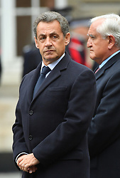 Former President Nicolas Sarkozy, Former Prime Minister Jean-Pierre Raffarin attending a ceremony in tribute to Captain Xavier Jugele, the police officer who was murdered by a terrorist on the Champs-Elysees last week, at Prefecture de Police in Paris, France on April 25, 2017. Photo by Christian Liewig/ABACAPRESS.COM