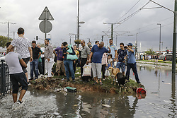 August 29, 2017 - Istanbul, Turkey - People try to stay dry as they stand on a mound of dirt in the middle of flooded street. Heavy rain in Turkey's biggest city caused substantial flooding on roads and in its Metro network. (Credit Image: © Can Erok/Depo Photos via ZUMA Wire)