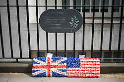 © licensed to London News Pictures. 06/05/2011. London, UK. Flowers left in the form of the British and US flags underneath a memorial plaque at Taverstock Square today (06/05/2011), the scene of one of the July 7 bombings. The coroner at the 7/7 London bombings inquests formally ruled that the 52 people who died in the suicide attacks were unlawfully killed. See special instructions for rates. Photo credit should read Ben Cawthra/LNP