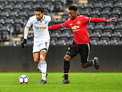 Kenji Gorre of Swansea City holds off Ethan Laird of Manchester United - Mandatory by-line: Craig Thomas/Replay images - 18/03/2018 - FOOTBALL - Liberty Stadium - Swansea, England - Swansea City U23 v Manchester United U23 - Premier League 2 - Divison 1