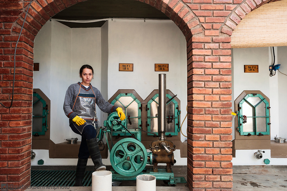 A winemaking assistant in front of the old piletas at the Nonno Coletto Artesenal winery in Tupungato, Argentina. MR