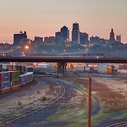 Kansas City Missouri skyline view from Kansas with railroads and trains in foreground. Taken for Performance Automotive.