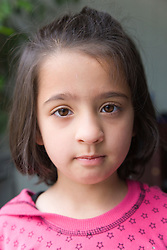 Portrait of a little girl looking thoughtful,