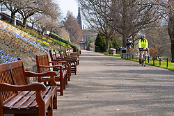 Edinburgh, Scotland, UK. 24 March, 2020.  West Princes Street Gardens are open but almost deserted. All shops and restaurants are closed with very few people venturing outside following the Government imposed lockdown today.  Iain Masterton/Alamy Live News