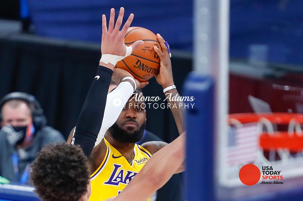 Jan 13, 2021; Oklahoma City, Oklahoma, USA; Los Angeles Lakers forward LeBron James (23) lines up his shot as Oklahoma City Thunder forward Isaiah Roby (22) defends the shot during the second half at Chesapeake Energy Arena. Mandatory Credit: Alonzo Adams-USA TODAY Sports