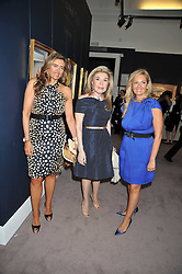 Left to right, CRISTINA GOULANDRI (Check spelling) her mother MARIANNA VARDINOYIANNIS Goodwill Ambassador of UNESCO and ELENA MAKRI LIBERIS at a party to celebrate the publication of Elena Makri Liberis's book 'Every Month, Same day' held at Sotheby's, 34-35 New Bond Street, London on 5th May 2009.