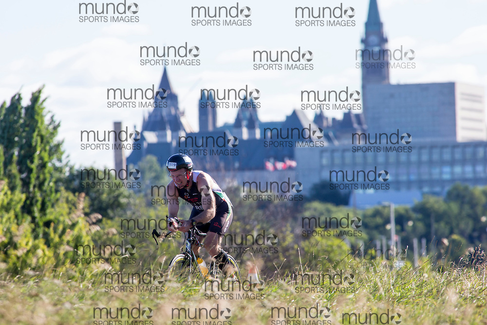 (Ottawa, Canada---10 August 2013)  Richard George Du Toit (519)  of South Africa (RSA) competing in the 50-54 Male AG International Triathlon Union 2013 World Duathlon Championships (10 km run- 40 km bike- 5km run).