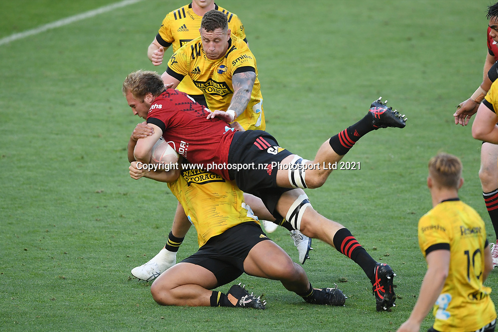 Crusaders Mitchell Dunshea is tackled in the Super Rugby match, Hurricanes v Crusaders, Sky Stadium, Wellington, Sunday, April 11, 2021. Copyright photo: Kerry Marshall / www.photosport.nz