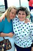 Downs syndrome woman and counselor age 40 at Lake Calhoun excursion.  Minneapolis  Minnesota USA