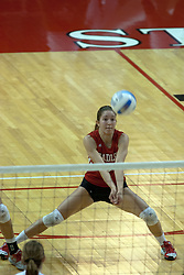 09 OCT 2005 Bradley Libero Gillian Falknor splits for a dig. The Illinois State University Redbirds hosted arch rival Bradley University Braves.  The Redbirds soared over the Braves, taking the match in 4 games, losing only game number 2.  Action included play by Braves Star Lindsey Stalzer who is ranked no. 7 in the nation in kills per game.  The first defeat of the conference season for the Braves took place at Redbird Arena on Illinois State's campus in Normal IL.