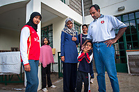 Nairobi, Kenya | 2007<br /> Former captain of Kenya's national cricket squad, which competed in the 1999 and 2003 World Cups, Aasif Karim poses with wife Nanzeen, daughters Fatema and Zainab, and sons Irfan and Imran. Kenya won two matches in 2003, and Aasif was named Man of the Match for his performance against Australia, even though his side lost. Now he is the managing director of an insurance brokerage in Nairobi and also works as a property developer.