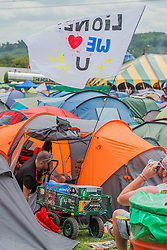 Lionel Ritchie fans stock up on beer. Arrivals face blistering heat as they struggle in with their kit. The 2015 Glastonbury Festival, Worthy Farm, Glastonbury.