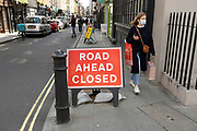 Road ahead closed and face masks on in Berwick Street in Soho on 26th May 2021 in London, United Kingdom. As the coronavirus lockdown continues its process of easing restrictions, more and more people are coming to the West End as more businesses open.