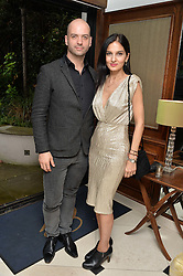 """YASMIN MILLS and JUSTIN HORNE at a party to celebrate the publication of """"Lady In Waiting: The Wristband Diaries"""" By Lady Victoria Hervey held at The Goring Hotel, Beeston Place, London on 9th May 2016."""