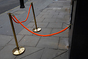 A new orange rope barrier outside a restaurant bar in Mayfair, on 5th January 2019, in London, England.