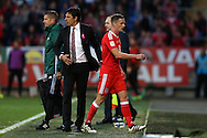 Chris Coleman, the Wales manager (l) looks on as he replaces Andy King of Wales (r)  in the 2nd half. Wales v Georgia , FIFA World Cup qualifier, European group D match at the Cardiff city Stadium in Cardiff on Sunday 9th October 2016. pic by Andrew Orchard, Andrew Orchard sports photography