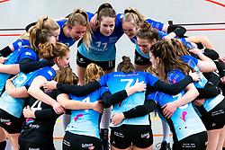 Team Zwolle yell with Sanne Konijnenberg of Zwolle before the first league match between Djopzz Regio Zwolle Volleybal - Laudame Financials VCN on February 27, 2021 in Zwolle.