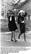 Kate Chancellor and the hon Clare Mosley holding onto their hats while arriving for the marriage of Lady Anne Somerset to Matthew Carr. Badminton. 26 March 1988. Film 88232f6<br />© Copyright Photograph by Dafydd Jones<br />66 Stockwell Park Rd. London SW9 0DA<br />Tel 0171 733 0108