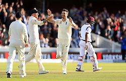England's James Anderson celebrates with Ben Stokes (left) after bowling West Indies' Kraigg Brathwaite to take his 500th Test wicket during day two of the Third Investec Test match at Lord's, London.