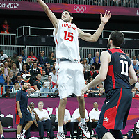 31 July 2012: Tunisia Salah Mejri grabs a rebound during 110-63 Team USA victory over Team Tunisia, during the men's basketball preliminary, at the Basketball Arena, in London, Great Britain.
