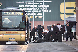 © Licensed to London News Pictures . 14/09/2015 . Manchester, UK . Prison staff with riot shields unload from a coach at HMP Manchester  (formerly Strangeways Prison ), where Stuart Horner is conducting a rooftop protest against prison conditions . Photo credit : Joel Goodman/LNP