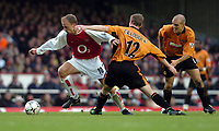 Photo: Richard Lane.<br /> Arsenal v Wolverhampton Wanderers. Barclaycard Premiership.<br /> 26/12/2003.<br /> Dennis Bergkamp breaks past Jody Craddock.