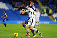 M K Dons Joe Walsh challenges Cardiff City's Kenneth Zohore. Skybet football league championship match, Cardiff city v MK Dons at the Cardiff city stadium in Cardiff, South Wales on Saturday 6th February 2016.<br /> pic by Carl Robertson, Andrew Orchard sports photography.