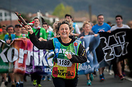 """A woman carrying the baton run on the 20th Korrika.  Hendaia (Basque Country). April 4, 2017. The """"Korrika"""" is a relay course, with a wooden baton that passes from hand to hand without interruption, organised every two years in a bid to promote the basque language. The Korrika runs over 11 days and 10 nights, crossing many Basque villages and cities. This year was the 20th edition and run more than 2500 Kilometres. Some people consider it an honour to carry the baton with the symbol of the Basques, """"buying"""" kilometres to support Basque language teaching. (Gari Garaialde / Bostok Photo)"""