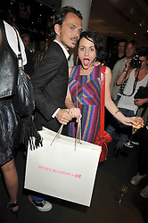 MATTHEW WILLIAMSON and JAIME WINSTONE at a party to celebrate the launch of the Matthew Williamson collection at H&M held at the H&M store, Regent Street, London on 22nd April 2009.