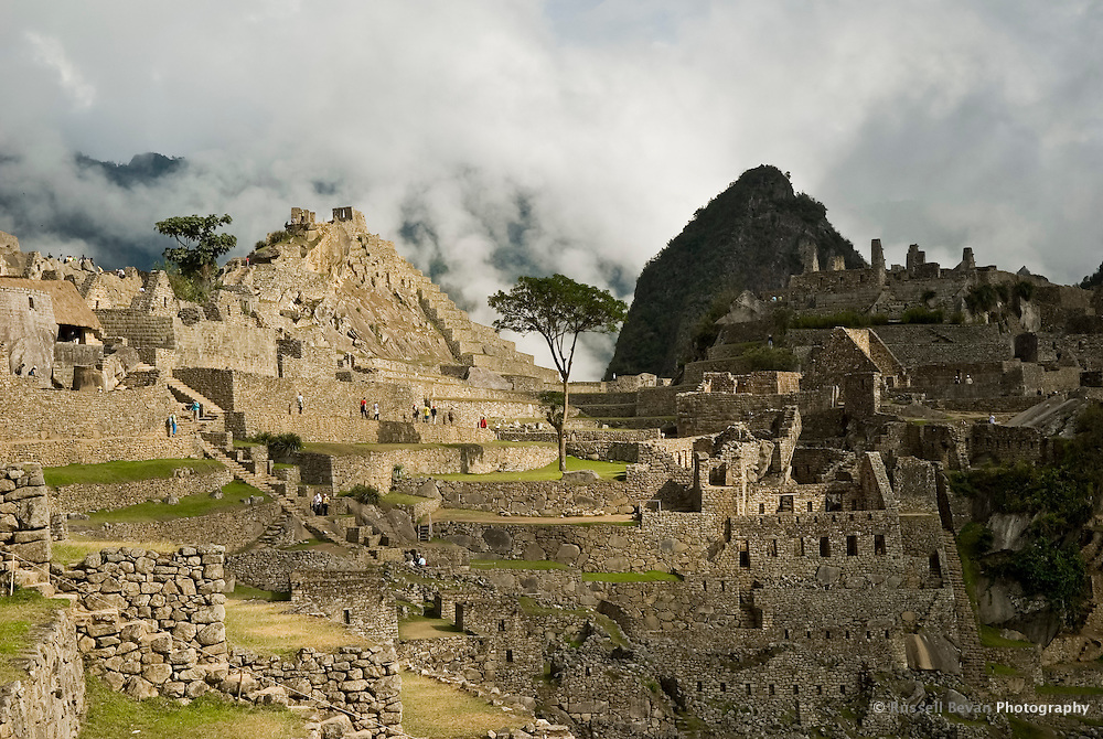The Intihuatana seen from the eastern Side of Machu Picchu from the agricultural terraces in the Peruvian Andes