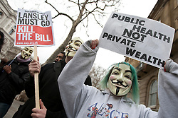 © licensed to London News Pictures. London, UK 17/03/2012. Anonymous members are at the UK Uncut demonstration against the Government's Health and Social Care Bill currently passing through Parliament, outside Department of Health, London. Photo credit: Tolga Akmen/LNP