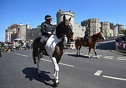 Mounted police before an armed forces parade rehearsal in Windsor, Berkshire ahead of the wedding of Prince Harry and Meghan Markle this weekend.