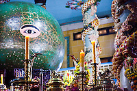 The altar in the Great Divine Temple contains a selection of symbolic items under the watch of the Divine Eye which sees all.
